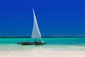 Sailing dhow on the beach in Zanzibar | PAS Safari Trip Extensions