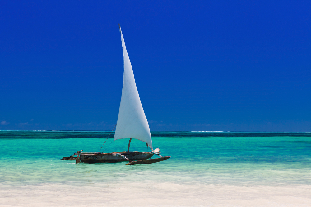 Sailing dhow on the beach in Zanzibar | PAS Safari Trip Extensions